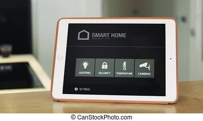 A tablet with smart home screen. - A tablet with smart home...