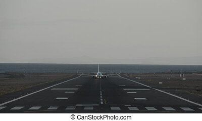 A taking off aircraft - A frontal shot of a taking off...