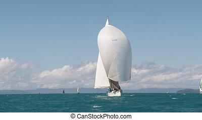 A tall white mast of a sailboat - A long shot of a sailboat...