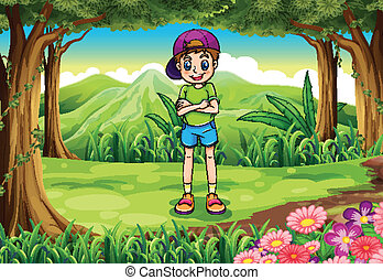 A tall young man standing in the middle of the forest