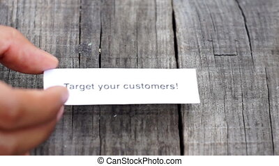Target your Customers - A Target your Customers paper sign ...
