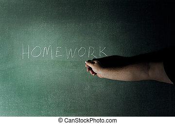Homework - A teacher with the word Homework written on a...