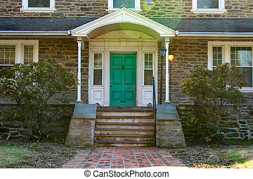 A Teal Front Door on a Suburban Home