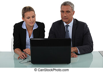 A team of business professionals reading an e-mail
