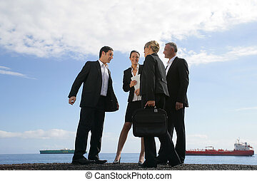 A team of businesspeople meeting on the quay
