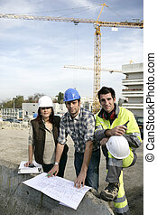 A team of construction workers working together
