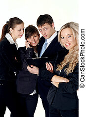 A team of four people communicate