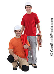 A team of tradespeople posing for the camera