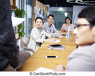 young asian entrepreneurs meeting in office