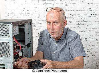a technician repairing a computer