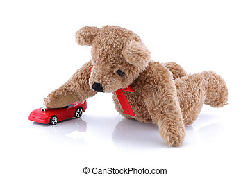 Teddy bear playing with his toy car