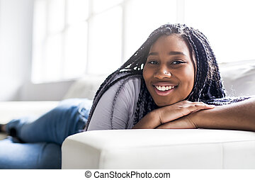 teen african young woman relaxing at home