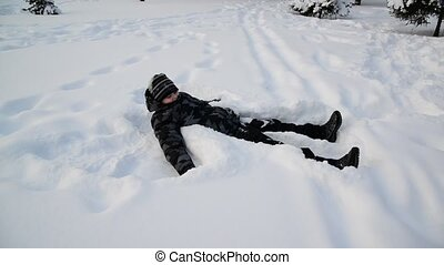 Teen boy playing in the snow