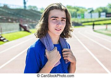teen boy ready to run outside on a training field