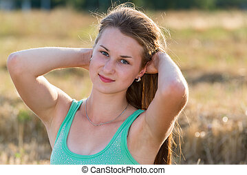 Teen girl resting in a field