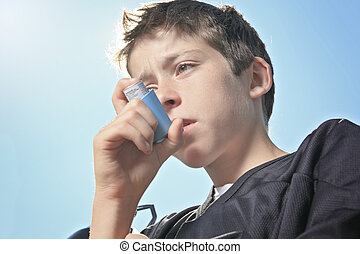 teen having a asthma problem with sky on the background