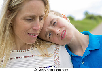 teen with son head on the shoulder