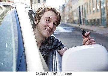 Teenage boy and new driver behind wheel of his car