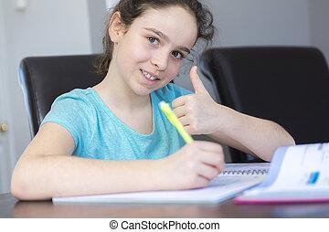 Teenage girl doing homework for school.