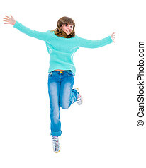 A teenage girl is jumping
