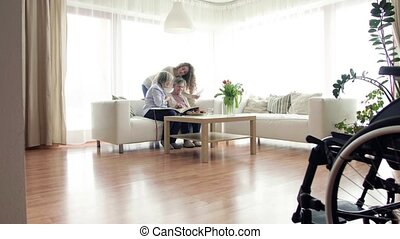 A teenage girl, mother and grandmother at home. - A teenage...