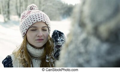 A teenage girl on a walk in winter nature.