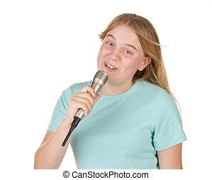 teenage girl singing karaoke