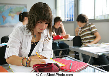 a teenage girl studying in a classroom