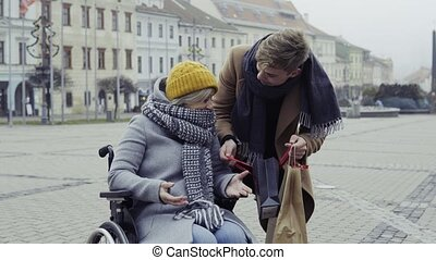 A teenager boy with disabled grandmother in wheelchair...