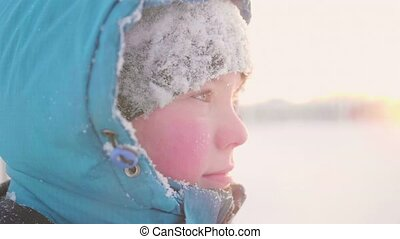 A teenager in winter Park, face closeup . The time of sunset. Walks in the fresh air. Healthy lifestyle