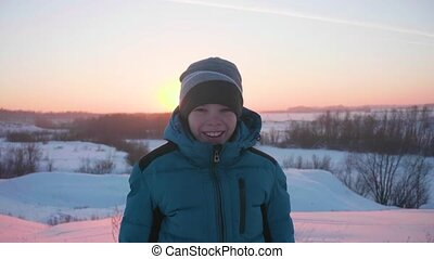 A teenager in winter Park smiling face closeup. Walking in the open air. A healthy lifestyle