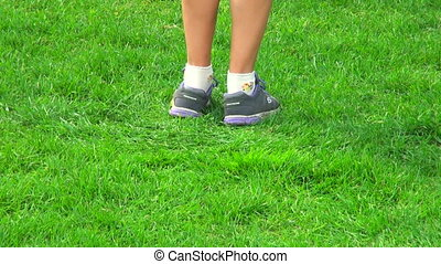 A teenager jumps on the grass