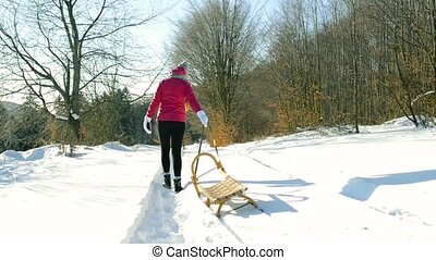 A teenager on a walk in winter nature.