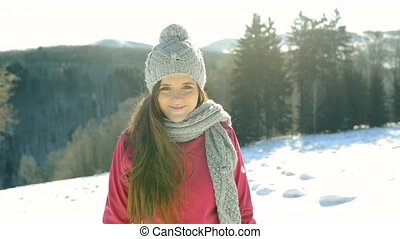 A teenager on a walk in winter nature. - A pretty teenage...