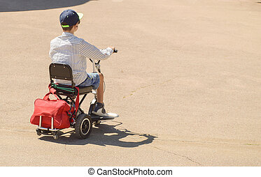 A teenager rides an electric scooter or Bicycle outdoors in the summer