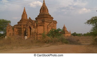 A temple with two stupas - An establishing shot of an...