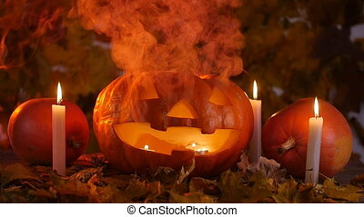 A terrible pumpkin in the smoke. Halloween concept