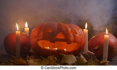 A terrible pumpkin in the smoke. Halloween concept - A ...