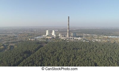 A thermoelectric plant with big chimneys. - A thermoelectric...