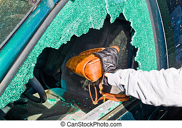 a thief stole a purse from car - a thief steals a purse from...