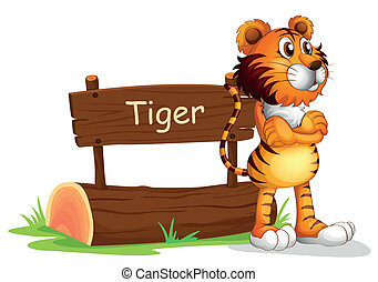 A tiger beside a wooden signboard