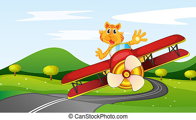A tiger riding in a plane