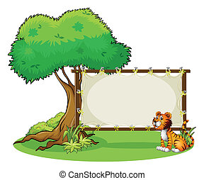 A tiger sitting at the right side of a signage -...