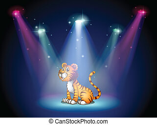 A tiger sitting on the stage with spotlights