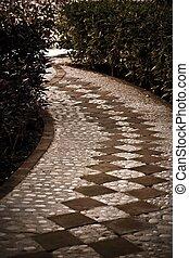 A tiled cobblestone path