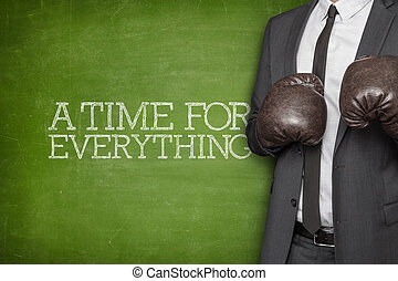 A Time for everything on blackboard with businessman