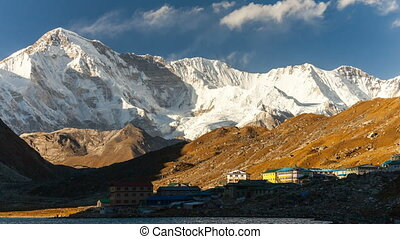 A time lapse video of clouds moving above Gokyo village and...