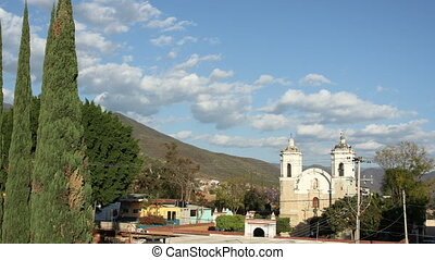 a timelapse a the sun sets over a church in outskirts of oaxaca, mexico