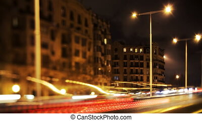 a timelapse of a street scene in barcelona at night, spain using tilt and shift lens