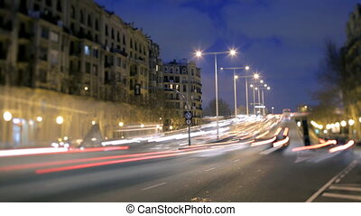 a timelapse of a street scene in barcelona at night, spain...